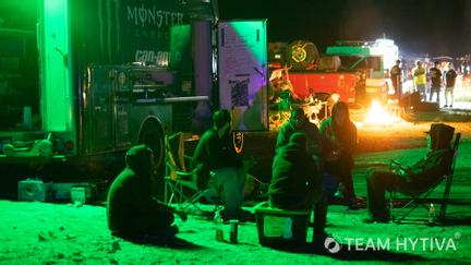 Pit Crew Lounging at Night