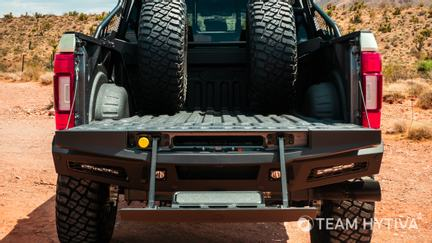 Rear View of the Tailgate Step Bed and Spare Wheels and Tires