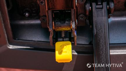 Yellow Release Button Number 2 on Tailgate Grab Bar