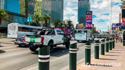 Team Hytiva Super Baja and F-250 and Trailer Driving down The Strip