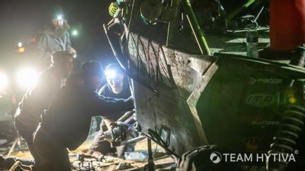 Crew working on UTV at Night