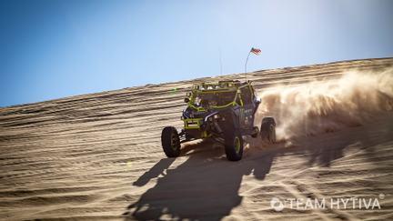 Marc Burnett in Monster Energy UTV on side of dune