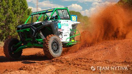 Team Hytiva RZR Kicking Up Red Dirt