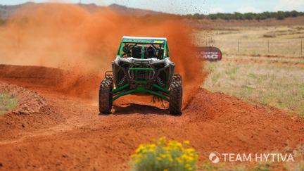 Polaris RZR Charging Around Dirt Turn