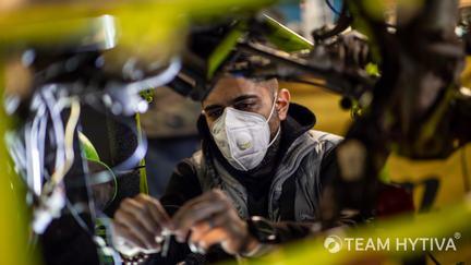 Mechanic Installing Wiring